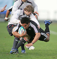 New Zealand fullback Trent Renata is brought to a halt by the Welsh defence in the Division A semi-final at Ravenhill.