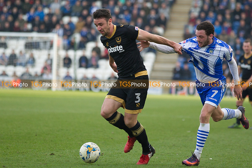 Enda Stevens of Portsmouth gets the better of Drey Wright of Colchester United during Colchester United vs Portsmouth, Sky Bet EFL League 2 Football at the Weston Homes Community Stadium on 11th March 2017