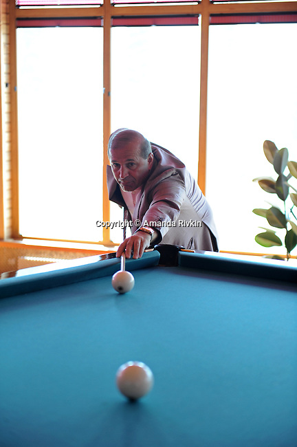 Ibrahim Ibrahimov, an Azerbaijani oligarch and billionaire, plays billards in one of several houses on his Caspian seaside property he used to inhabit with his family in the Garadagh region just southwest of Baku, Azerbaijan on July 18, 2012.  Ibrahimov is the developer behind the Khazar Islands artificial islands project; in his private life, he enjoys building a home for his family, moving in, and then quickly tires of the property before building a new home on an adjacent lot on his seaside lands.