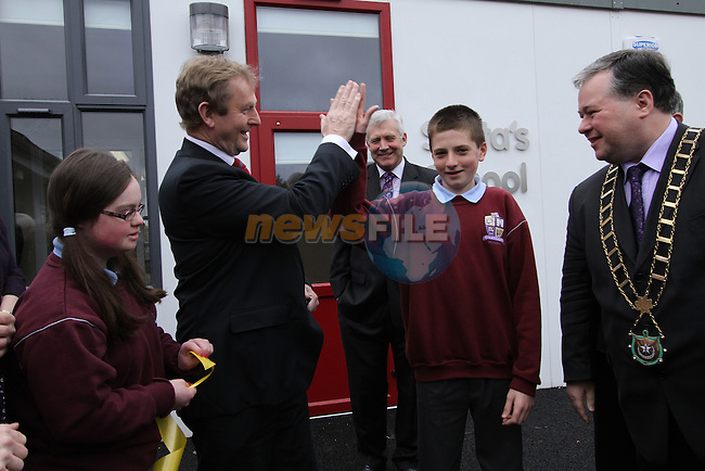 Taoiseach Enda Kenny with Megan McCormack and Ciaran Jordan as he visits St.Endas School in Drogheda to celebrate 50 Years Open and to Open the New Building...(Photo credit should read Jenny Matthews/NEWSFILE)...