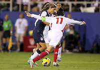 BOCA RATON, FL - DECEMBER 15, 2012: Tobinn Heath (17) of the USA WNT moves past Pu Wei (11) of China WNT during an international friendly match at FAU Stadium, in Boca Raton, Florida, on Saturday, December 15, 2012. USA won 4-1.