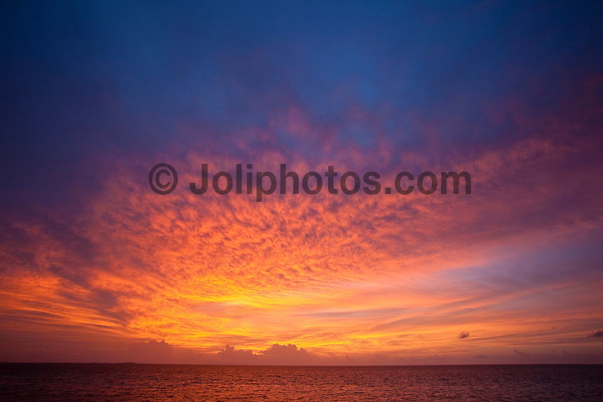 A sunset from aboard the Vaagali MV during a surfing boat trip in the  Maldives (Wednesday, June 10th, 2009). Photo: joliphotos.com