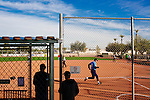 Two of the 31 softball teams in Sun City play on the fields near the Sun Bowl in Sun City, Arizona December 3, 2013. While the rules are slightly amended to protect the aging players (no sliding), the games are intense for the 55-92 year old players. Sun City, Arizona was the first age-restricted city of retirees when it opened in 1960.