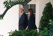 United States President Donald J. Trump and first lady Melania Trump depart the White House in Washington, DC en route to Joint Base Andrews where they will pay their respects to the family of fallen United States Secret Service Special Agent Nole Edward Remagen who suffered a stroke while on duty in Scotland on Wednesday, July 18, 2018.<br /> Credit: Ron Sachs / CNP