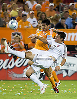 D.C. United defender Marc Burch (4) knocks the ball away from Houston Dynamo forward Brian Ching (25).  Houston Dynamo defeated D.C. United 4-3 at Robertson Stadium in Houston, TX on August 1, 2009.