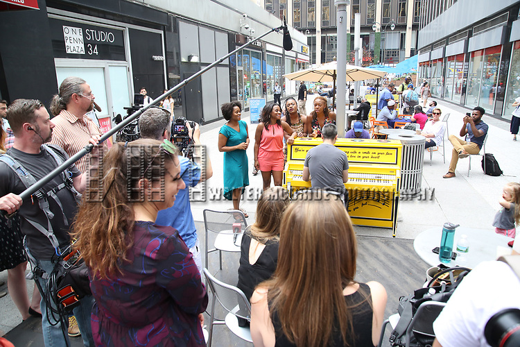 The cast of 'Beautiful - The Carole King Musical' unveil a special 'Sing For Hope' Piano with a public Pop-Up performance at One Penn Plaza East  on June 21, 2017 in New York City.