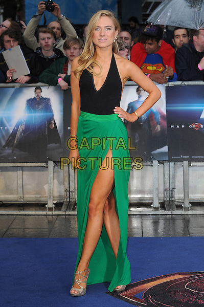 Kimberley Garner<br /> 'Man Of Steel' UK film premiere, Empire cinema, Leicester Square, London, England.<br /> 12th June 2013<br /> full length black halterneck top green skirt slit split silver shoes hand on hip  <br /> CAP/BEL<br /> &copy;Tom Belcher/Capital Pictures