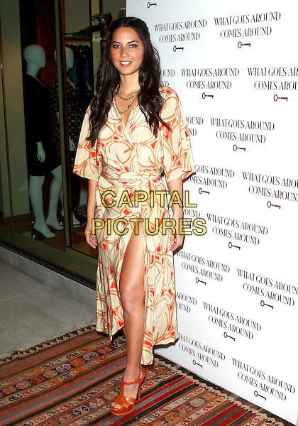 OLIVIA MUNN .WGACA 1 Year Anniversary Party  held at Space15Twenty, Los Angeles, California, USA, 18th March 2010..one arrivals full length cream orange red print long dress kimono leg slit split thigh sandals platform YSL shoes wrap printed .CAP/ADM/TC.©T. Conrad/AdMedia/Capital Pictures.