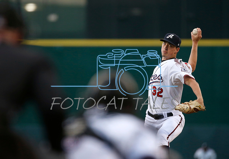 Reno Aces' Taylor Clark pitches against the Albuquerque Isotopes during their home opener in Reno, Nev., on Tuesday, April 9, 2019.  The Aces won 4-2. <br />
