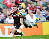 London, England. Chris Ashton of Saracens tackled by Marland Yarde of London Irish during the Aviva Premiership match between London Wasps  and Harlequins at Twickenham Stadium on September 1, 2012 in Twickenham, England.