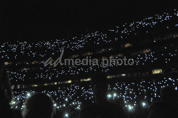12 June 2016 - Nashville, Tennessee - Audience during moment of silence for to honor Orlando shooting victims. 2016 CMA Music Festival Nightly Concert held at Nissan Stadium. Photo Credit: Dara-Michelle Farr/AdMedia