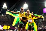 Engeland, London, 4 Augustus 2012.Olympische Spelen London.Finale 100 meter Mannen .Usain Bolt (goud) en Yohan Blake (zilver) uit Jamaica juichen de finale van de 100 meter.