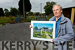 Pierce Wallace from Tralee holding a picture of his house at the site where it stood in St Johns Cemetery on Brewery Rd.