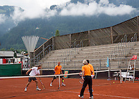 Austria, Kitzbuhel, Juli 14, 2015, Tennis, Davis Cup, Training Dutch team, warming up with a game of touch, ltr: Captain Jan Siemerink, coach Martin Bohm,  Thiemo de Bakker and Robin Haase<br /> Photo: Tennisimages/Henk Koster