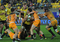 Ardie Savea is wrapped up during the Super Rugby match between the Hurricanes and Jaguares at Westpac Stadium in Wellington, New Zealand on Friday, 17 May 2019. Photo: Dave Lintott / lintottphoto.co.nz