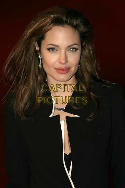 "ANGELINA JOLIE.UK film premiere of ""Alexander"",.Odeon Cinema Leicester Square, London, .January 5th 2004..portrait headshot silver drop earrings.Ref: AH.www.capitalpictures.com.sales@capitalpictures.com.©Capital Pictures."