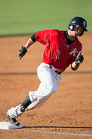Eddy Alvarez (1) of the Kannapolis Intimidators rounds third base on his way to scoring a run against the Hickory Crawdads at CMC-Northeast Stadium on May 21, 2015 in Kannapolis, North Carolina.  The Intimidators defeated the Crawdads 2-0 in game one of a double-header.  (Brian Westerholt/Four Seam Images)