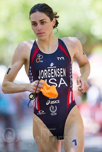 01 JUN 2013 - MADRID, ESP - Gwen Jorgensen (USA) of the USA heads for transition at the end of the swim during the elite women's ITU 2013 World Triathlon Series round in Casa de Campo, Madrid, Spain   (PHOTO (C) 2013 NIGEL FARROW)