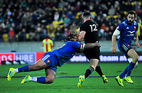 France's Mathieu Bastareaud tackles NZ's Ryan Crotty during the Steinlager Series international rugby match between the New Zealand All Blacks and France at Westpac Stadium in Wellington, New Zealand on Saturday, 16 June 2018. Photo: Dave Lintott / lintottphoto.co.nz