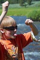 Boy  fly-fishing the Gardiner River in Yellowstone National Park