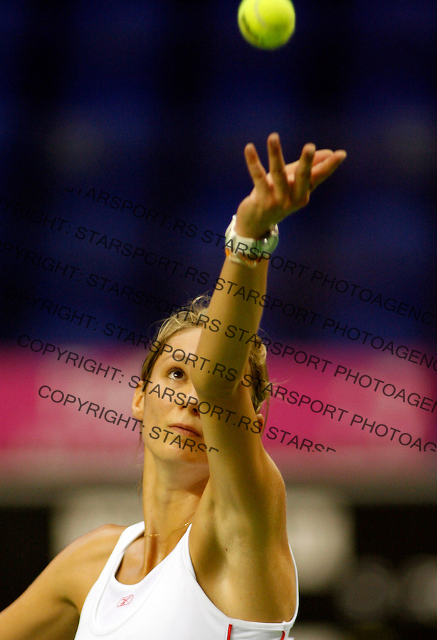 Serbian tennis player Vojislava Lukic,serves ball to Slovakia's Daniela Hantuchova, during play-off match Slovakia against Serbia in Federation Cup, Kosice, Slovakia, July 15, 2007. (Srdjan Stevanovic/starsportphoto.com)