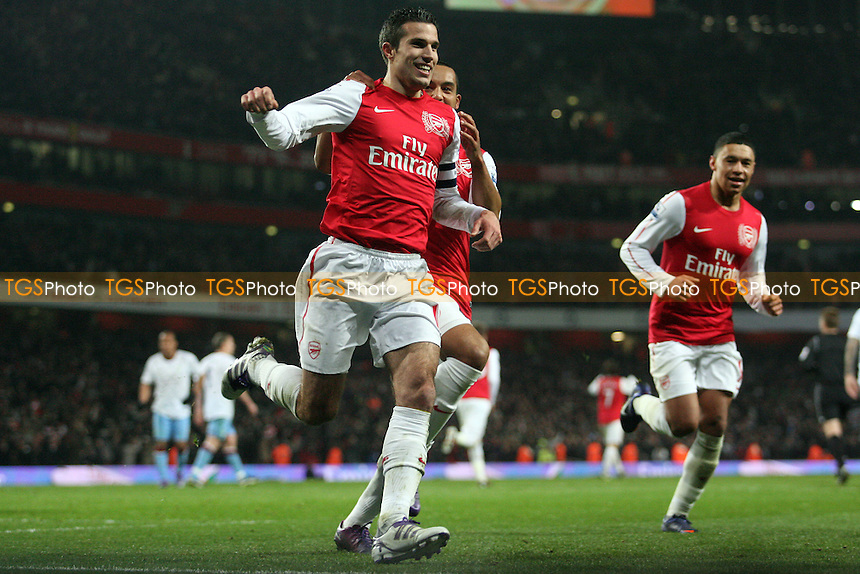 Robin van Persie of Arsenal celebrates scoring the third Arsenal goal -  Arsenal vs Aston Villa - at the Emirates Stadium - 29/01/12 - MANDATORY CREDIT: Dave Simpson/TGSPHOTO - Self billing applies where appropriate - 0845 094 6026 - contact@tgsphoto.co.uk - NO UNPAID USE.