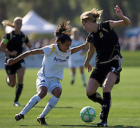 Marta (left) and Leigh Ann Robinson (7) struggle for control of the ball. Los Angeles Sol defeated FC Gold Pride 2-0 at Buck Shaw Stadium in Santa Clara, California on May 24, 2009.
