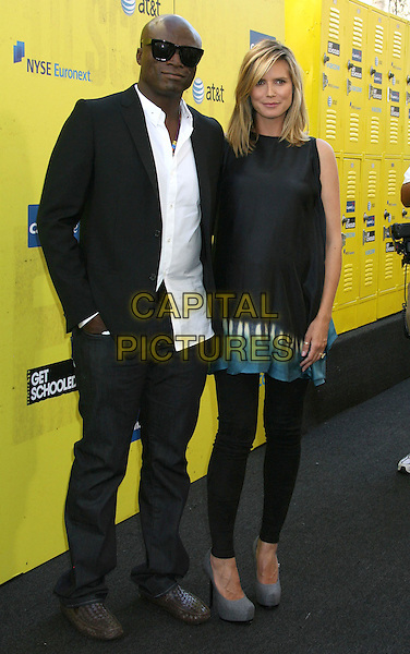 "SEAL (Seal Henry Olusegun Olumide Adeola Samuel) & HEIDI KLUM.""Get Schooled"" Los Angeles Conference & Premiere held at Paramount Studios in Hollywood, California, USA. .September 8th, 2009 .full length black suit jacket silk satin top leggings jeans denim snakeskin shoes sunglasses shades married husband wife pregnant grey gray platform white shirt hand in pocket.CAP/ADM/MJ.©Michael Jade/AdMedia/Capital Pictures."