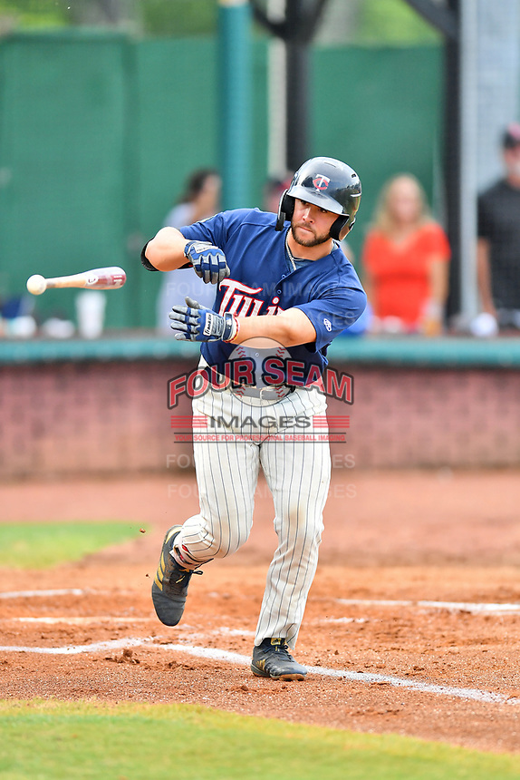Elizabethton Twins designated hitter Charlie Mack (27) tosses his bat after being walked during a game against the Kingsport Mets at Joe O'Brien Field on July 6, 2019 in Elizabethton, Tennessee. The Twins defeated the Mets 5-3. (Tony Farlow/Four Seam Images)