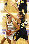 SIOUX FALLS, SD - JANUARY 2:  Amber Paden #42 from the University of Sioux Falls looks to the basket around the defense of Nicole Kerkhoff #32 from Augustana in the second half of their game Friday night at the Stewart Center. (Photo by Dave Eggen/Inertia)