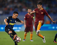 Calcio, Serie A: Roma vs Inter. Roma, stadio Olimpico, 2 ottobre 2016.<br /> FC Inter&rsquo;s Yuto Nagatomo, left, is challenged by Roma&rsquo;s Diego Perotti during the Italian Serie A football match between Roma and FC Inter at Rome's Olympic stadium, 2 October 2016.<br /> UPDATE IMAGES PRESS/Isabella Bonotto