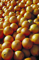 close-up of pile of oranges.  fruit, citrus, vitamin C. California.