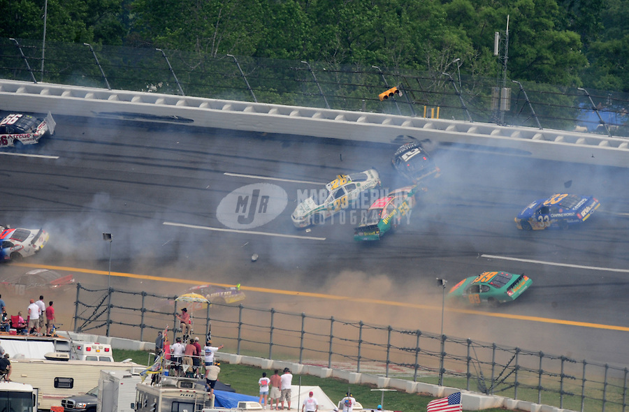 """Apr 26, 2008; Talladega, AL, USA; NASCAR Nationwide Series driver Carl Edwards (60) goes airborne after contact with Kevin Lepage (61) as David Reutimann (00) and Steve Wallace (66) spin during a multi car accident during the Aarons 312 at the Talladega Superspeedway. The crash was started when Lepage was exiting pit road and pulled up into the field going 100mph slower than the pack of cars going over 190mph. Initially Lepage blamed the other drivers for not going around him but  """"After reviewing the tapes of the accident I realize I need to apologize to NASCAR, the car owners, my fellow competitors and, most importantly, the fans,"""" he said in a statement released by his team, Specialty Racing. """"I made a huge driver error by blending onto the race track in the wrong area. This caused a multicar accident and changed the outcome of the race for many teams..Mandatory Credit: Mark J. Rebilas"""