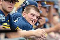 Michigan Wolverines pitcher Ben Keizer (14) in the dugout before Game 6 of the NCAA College World Series against the Florida State Seminoles on June 17, 2019 at TD Ameritrade Park in Omaha, Nebraska. Michigan defeated Florida State 2-0. (Andrew Woolley/Four Seam Images)