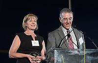 Betty Collins P'07 and Mike Collins P'07, parents of Andy Collins '07, receive his recognition in his honor. Andy Collins '07 led the Tigers to a 27–0 SCIAC record during his three-year tenure as quarterback (2004–2006) and is regarded as the most dominant SCIAC football player in the modern era. Collins, who died in 2011, was the SCIAC's first three-time Offensive Player of the Year and the top quarterback in NCAA Division III as chosen by the American Football Coaches Association.<br /> The Occidental community celebrates its student-athletes with the induction of the sixth class into the Occidental College Athletics Hall of Fame during Homecoming and Family Weekend on Friday, Oct. 13, 2017 in Jack Kemp Stadium. The 2017 inductees are Stephen Haas '63 (track and field), the 1982 women's tennis team (NCAA national champions), Blair Slattery '94 (basketball and tennis), and the late Andy Collins '07 (football, track and field).<br /> (Photo by Marc Campos, Occidental College Photographer)