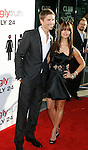 """HOLLYWOOD, CA. - July 16: Eric Winter and Roselyn Sanchez arrive at the Los Angeles premiere of """"The Ugly Truth"""" held at the Pacific's Cinerama Dome on July 16, 2009 in Hollywood, California."""