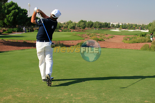 Damien McGrane tees off on the 1st tee during Day 1 of the Dubai World Championship, Earth Course, Jumeirah Golf Estates, Dubai, 25th November 2010..(Picture Eoin Clarke/www.golffile.ie)