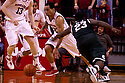 31 December 2011: Bo Spencer #23 of the Nebraska Cornhuskers steals the ball from Draymond Green #23 of the Michigan State Spartans during the second half at the Devaney Sports Center in Lincoln, Nebraska. Michigan State defeated Nebraska 68 to 55.