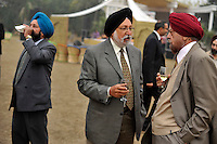 People drink at a reception after the wedding ceremony of British/Punjabi couple Lindsay and Navneet Singh at Grewal Farms in Amritsar.