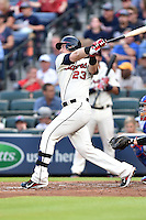 Atlanta Braves first baseman Chris Johnson (23) swings at a pitch during a game against the Chicago Cubs on July 18, 2015 in Atlanta, Georgia. The Cubs defeated the Braves 4-0. (Tony Farlow/Four Seam Images)