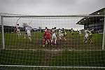 The home team defend their lead during the closing stages of the match as AFC Fylde (in white) took on Aldershot Town in a National League game at Mill Farm, Wesham. The fixture was played against the backdrop of the total postponement of all Premier League and EFL football matches due to the the coronavirus outbreak. The home team won the match 1-0 with first-half goal by Danny Philliskirk watched by a crowd of 1668.
