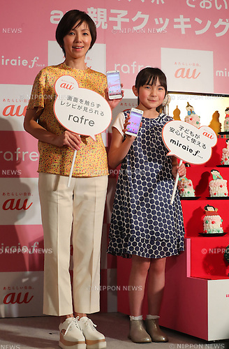 """March 2, 2017, Tokyo, Japan - Japanese actress Marina Watanabe (L) and Rio Suzuki bake a roll-cake using a cooking app of the new smart phone """"rafre"""", produced by Kyocera in Tokyo on Thursday, March 2, 2017. The new handset features a hand gesture sensor which enablees to scroll display without touching screen.    (Photo by Yoshio Tsunoda/AFLO) LwX -ytd-"""