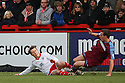 Luke Freeman of Stevenage (on loan from Arsenal) is tackled by Michael Kay of Tranmere. - Stevenage v Tranmere Rovers - npower League 1 - Lamex Stadium, Stevenage - 17th December 2011  .© Kevin Coleman 2011 ... ....  ...  . .