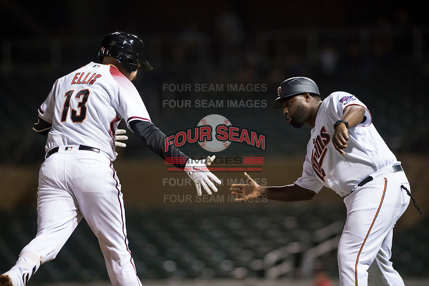 Salt River Rafters manager Tommy Watkins (8), of the Minnesota Twins organization, congratulates Drew Ellis (13), of the Arizona Diamondbacks organization, after he hit a home run during an Arizona Fall League game against the Scottsdale Scorpions at Salt River Fields at Talking Stick on October 11, 2018 in Scottsdale, Arizona. Salt River defeated Scottsdale 7-6. (Zachary Lucy/Four Seam Images)
