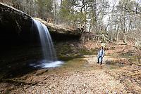 NWA Democrat-Gazette/FLIP PUTTHOFF <br /> Linda Heter admires the Glory B waterfall in the Madison County Wildlife Management Area.