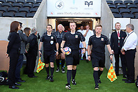 Match officials exit the tunnel during the Alan Tate Testimonial Match, Swansea City Legends v Manchester United Legends at the Liberty Stadium, Swansea, Wales, UK