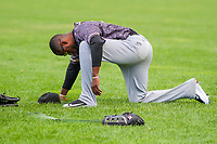 Quad Cities River Bandits outfielder Bryan De La Cruz (30) kneels to pray prior to a Midwest League game against the Beloit Snappers on June 18, 2017 at Pohlman Field in Beloit, Wisconsin.  Quad Cities defeated Beloit 5-3. (Brad Krause/Krause Sports Photography)
