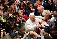 Papa Francesco saluta alcuni bambini al termine della sua visita pastorale alla chiesa di Santo Stanislao dei Polacchi a Roma, 4 maggio 2014.<br /> Pope Francis greets some children at the end of his pastoral visit to the church of St. Stanislaw of Poles in Rome, 4 May 2014.<br /> UPDATE IMAGES PRESS/Riccardo De Luca<br /> <br /> STRICTLY ONLY FOR EDITORIAL USE