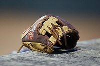 A Rawlings baseball glove sits on top of the third base dugout during the game between the Deep River Muddogs and the High Point-Thomasville HiToms at Finch Field on June 27, 2020 in Thomasville, NC.  The HiToms defeated the Muddogs 11-2. (Brian Westerholt/Four Seam Images)