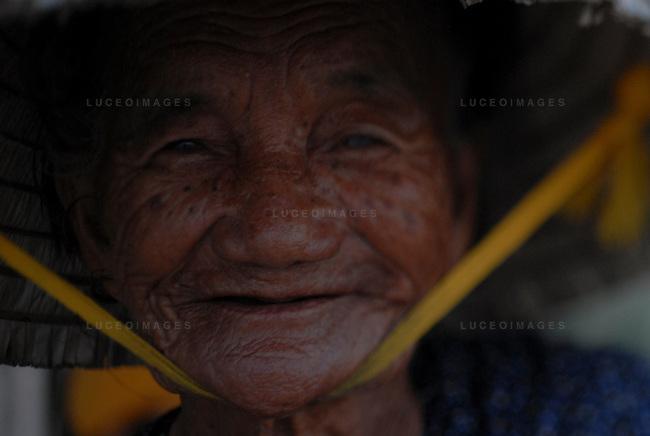 An old woman in Hoi An, Vietnam.